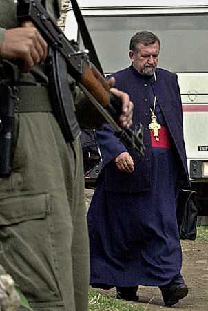 orthodoxpriestwalksbyterroristsept21.jpg